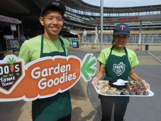 "Daniel Yang and friend working in Urban Roots' ""Root for the Home Team"" program"